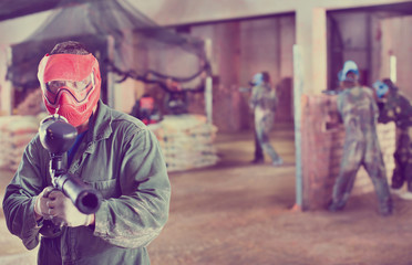 Player in red mask in paintball club