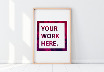 Wooden Framed Poster in Empty Room Mockup 1