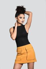 Beautiful Woman wearing a Black Tank Top and Yellow Skirt