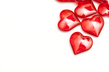 Red love hearts on a plain white background