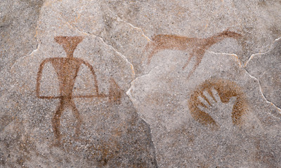 hunter, animal, hand painted ocher on the wall of the cave by an ancient man. ancient images. archeology