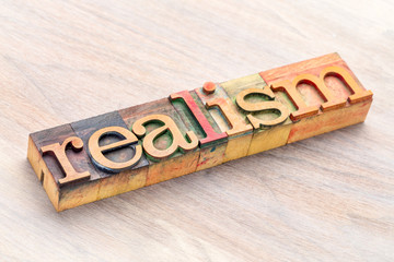realism word abstract in wood type