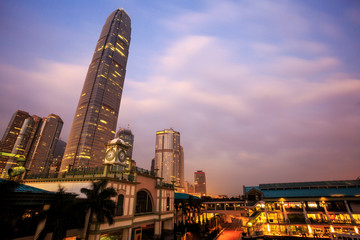 Clock Tower at central pier Hong Kong in early morning with tall building, morning sky burst