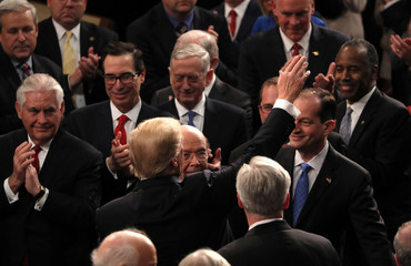 U.S. President Trump is greeted as he arrives to deliver his State of the Union address in Washington