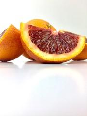 Blood orange slices on a white background