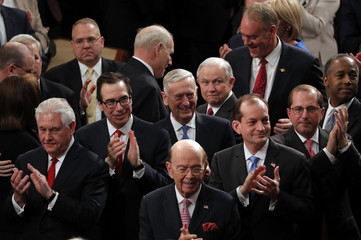 President Donald Trump's cabinet applaud him as he arrives for his State of the Union address to a joint session of the U.S. Congress on Capitol Hill in Washington