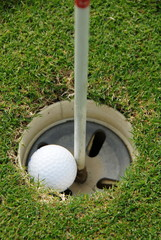 Players View of knocking the golf ball into the hole.