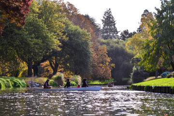 Christchurch,New Zealand  -April 30,2016:  Punting On The Avon.Sightseeing rides in a small, flat-bottomed boat poled by a guide dressed in Edwardian clothing