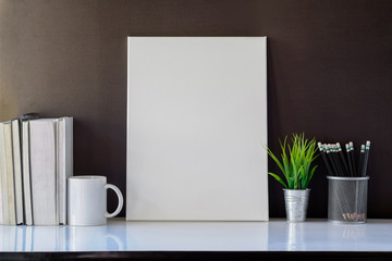 Mockup poster and coffee mug on white desk