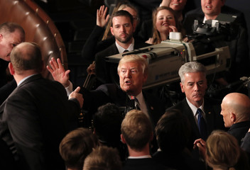 U.S. President Trump waves as he departs after delivering his State of the Union address in Washington