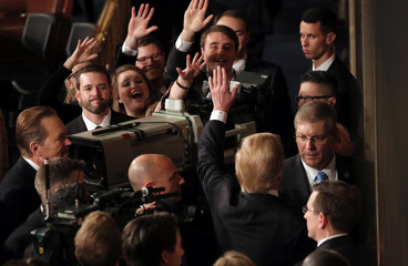 President Trump waves to Senate pages while he departs after delivering his State of the Union address in Washington
