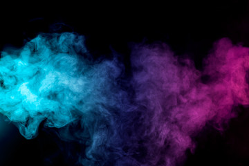 Fototapeten Rauch Dense multicolored smoke of red, purple and pink colors on a black isolated background. Background of smoke vape