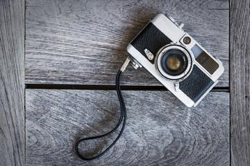 Retro vintage classic camera film on wood background