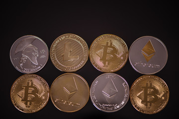 selection of different cryptocurrency coins ethereum bitcoin litecoin titan