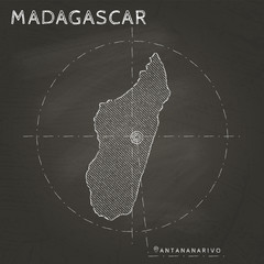 Madagascar chalk map with capital marked hand drawn on textured school blackboard. Chalk Madagascar outline with Antananarivo marked. Vector illustration.