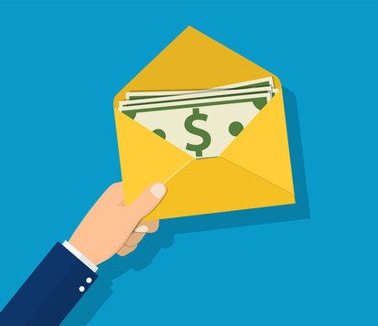 Money in envelope hold in hand businessman.