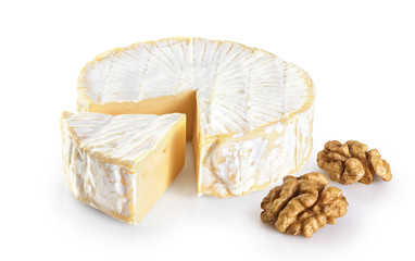 Camembert cheese and walnuts isolated on white background.