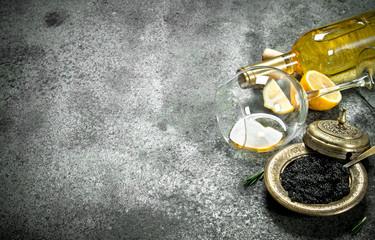 Black caviar with white wine and lemon.