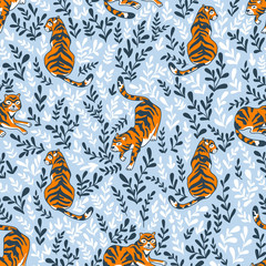 Vector seamless pattern with tigers isolated on the floral background. Animal background for fabric or wallpaper boho design.