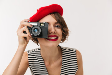 Portrait of a smiling woman wearing red beret