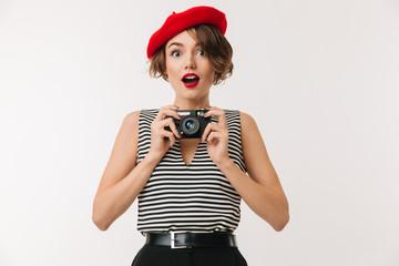 Portrait of a joyful woman wearing red beret