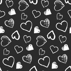 Monochrome seamless pattern with cute grunge white scribbled hearts on black background. Contrast doodle texture for St. Valentines lovely design, textile, wrapping paper, cover, background, wallpaper