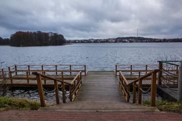 Footbridge on the Czos lake in Mragowo, Masuria, Poland