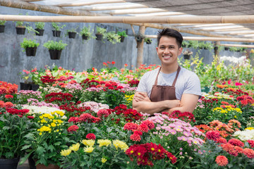 asian male florist working in flower shop