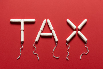Tampons Forming the Word TAX on a Red Background