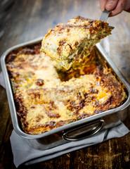 Lasagna bolognese. Typical homemade fresh green pasta cooked in oven.