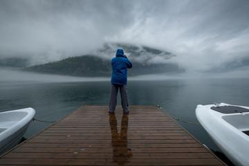Man taking a photo, Geiranger Fjord, More og Romsdal, Norway