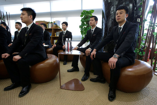 Members of JD's VIP delivery team attend a training of business etiquette in Beijing