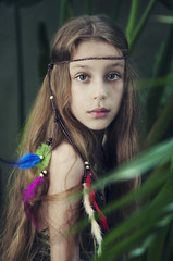 Portrait of a girl wearing a bohemian feather headdress