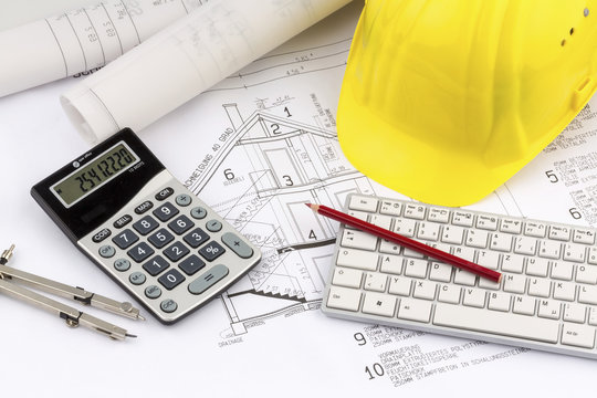house plan with a construction worker's helmet