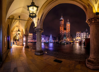 Market Square of Krakow and St. Mary's Basilica. Morning and lights