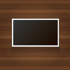 vintage photo frame with shadow isolated on wooden wall background. Vector Photo realistic Mockups with empty space for photo.