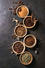 Variety of grounded, instant coffee, different coffee beans, brown sugar, spices in wooden bowls...
