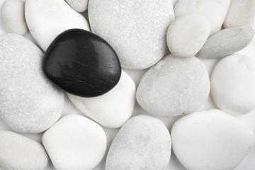 Black and white pebbles stone texture. Spa therapy conceptual background