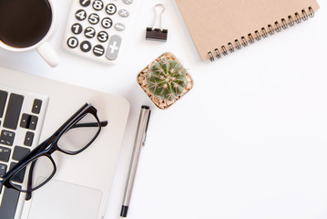 White office desk table, workspace office with laptop, smartphone black screen, coffee cup,pen,calculator, glasses, Top view with copy space