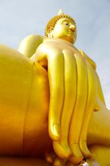 Young man worship a big buddha image with peace at Wat muang Ang Thong province