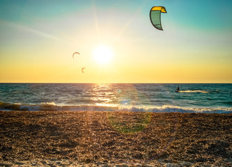 kitesurfers and sunset flare
