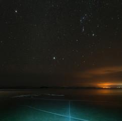 Starry sky over crack Baikal ice