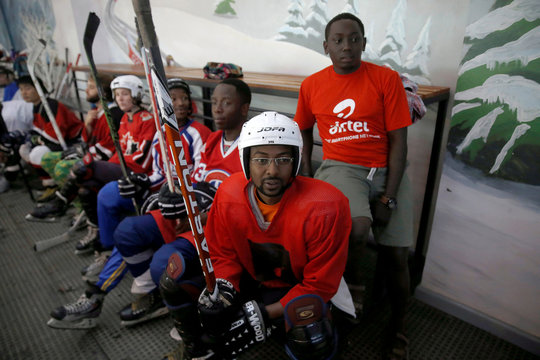 Members of Kenya's ice hockey team sit on the bench during a practice session in East Africa's only ice rink, in Nairobi