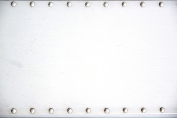Metallic background framed by rivets and empty copy space for Editor's text.