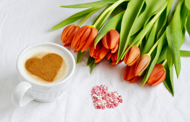 Cappuccino with Heart Pattern of Cinnamon and Flowers Composition Tulips White Background Valentines Day Spring Concept