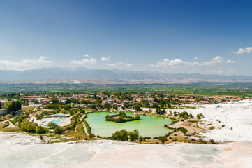 Sonny view of natural travertine pools and terraces in Pamukkale, Denizli province, Turkey.