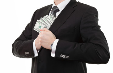 Businessman putting a lot of money into his inner pocket of suit
