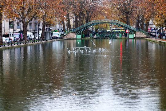 Autumn by Saint Martin canal in Paris, France.
