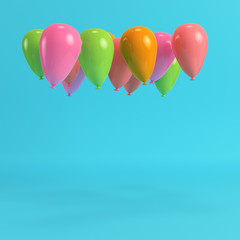 Colorfull balloons on bright blue background