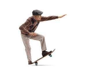 Senior riding a skateboard and doing a manual